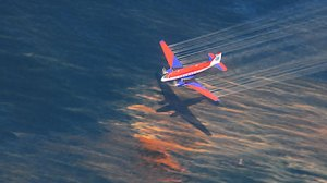 Dispersant by plane in the Gulf of Mexico.  Photo: coastalcare.org.