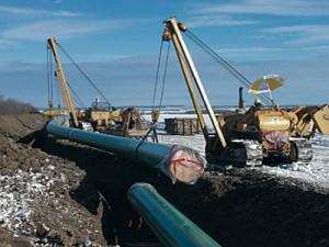 Working on the Keystone pipeline.  Photo: thinkprogess.org.