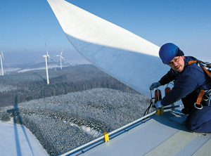 Wind turbine repair.  Photo: Think Progress.