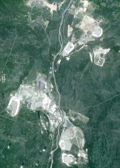 Looking down at the Alberta Tar Sands.  Following the Athabasca river (in the middle), the site is more than 60 km long.