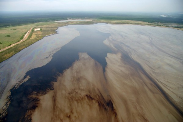 "A tailings pond of toxic waste water from the processing of tar sands.  Does this look ""environmentally sustainable"" to you?  Image: David Dodge, Pembina Institute."